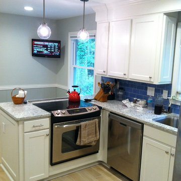 Shaker Style Cabinets with Crown Molding and Gray Granite Countertops