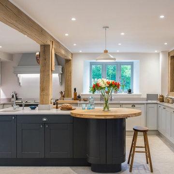 Shaker style kitchen in graphite & light grey with light quartz worktop & oak