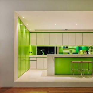 Mid-sized contemporary open concept kitchen designs - Example of a mid-sized trendy l-shaped open concept kitchen design in Melbourne with flat-panel cabinets, white cabinets, glass sheet backsplash, paneled appliances and an island