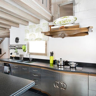 Design ideas for an eclectic kitchen in Moscow with a double-bowl sink, flat-panel cabinets, stainless steel cabinets, with island, white splashback and black appliances.