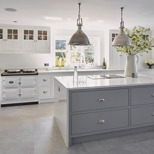 Medium sized classic single-wall kitchen in Oxfordshire with flat-panel cabinets, grey cabinets, white appliances, an island, grey floors and white worktops.
