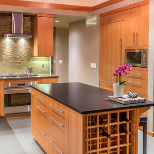 This is an example of a mid-sized contemporary l-shaped separate kitchen in Other with flat-panel cabinets, medium wood cabinets, green splashback, panelled appliances, with island, an undermount sink, quartz benchtops, glass tile splashback and porcelain floors.