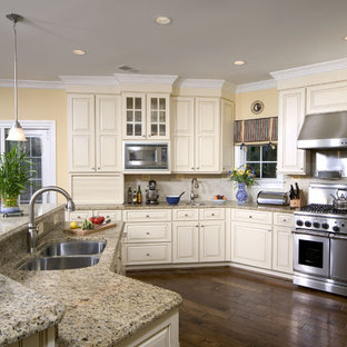 Inspiration for a timeless kitchen remodel in DC Metro with a double-bowl sink, stainless steel appliances, granite countertops, raised-panel cabinets and beige cabinets