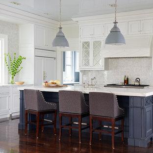 Inspiration for a large coastal dark wood floor kitchen remodel in Jacksonville with recessed-panel cabinets, white cabinets, beige backsplash, mosaic tile backsplash, paneled appliances and an island