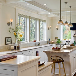Design ideas for a victorian kitchen in Burlington with wood worktops, recessed-panel cabinets, white cabinets and stainless steel appliances.