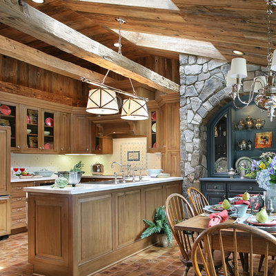 Large mountain style u-shaped medium tone wood floor eat-in kitchen photo in Las Vegas with paneled appliances, a drop-in sink, beaded inset cabinets, medium tone wood cabinets, white backsplash, ceramic backsplash and a peninsula