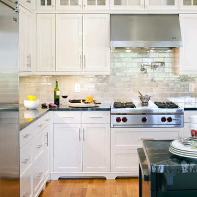 Inspiration for a victorian kitchen remodel in Boston with recessed-panel cabinets, stainless steel appliances, white cabinets, metallic backsplash and subway tile backsplash