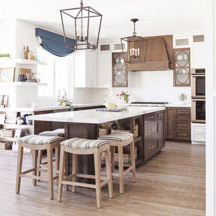 Coastal kitchen pictures - Inspiration for a coastal l-shaped light wood floor and beige floor kitchen remodel in San Diego with shaker cabinets, medium tone wood cabinets, white backsplash, an island and white countertops