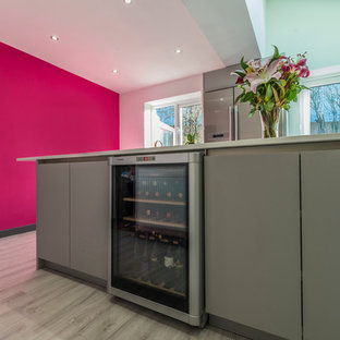 Shocking pink wall and splashback makes a big statement