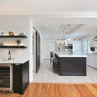 Design ideas for a mid-sized transitional l-shaped kitchen pantry in Newark with an undermount sink, recessed-panel cabinets, white cabinets, quartz benchtops, white splashback, panelled appliances, porcelain floors, with island, multi-coloured floor and white benchtop.