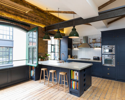 Large Industrial Open Concept Kitchen Remodeling   Example Of A Large Urban  Galley Medium Tone Wood