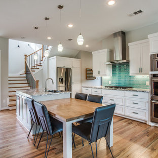 Example of a large transitional galley medium tone wood floor and brown floor eat-in kitchen design in Dallas with shaker cabinets, white cabinets, blue backsplash, stainless steel appliances, an island, an undermount sink, granite countertops and matchstick tile backsplash