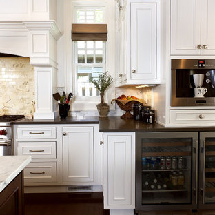 Open concept kitchen - large traditional l-shaped dark wood floor open concept kitchen idea in Other with stainless steel appliances, flat-panel cabinets, white cabinets, granite countertops, beige backsplash, an island and a farmhouse sink