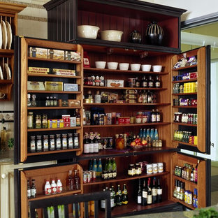 Traditional kitchen pantry designs - Inspiration for a timeless kitchen pantry remodel in Boston with recessed-panel cabinets