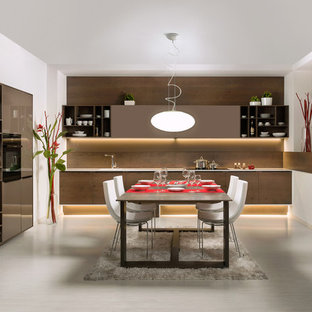 Inspiration for a mid-sized contemporary galley eat-in kitchen in Other with an integrated sink, flat-panel cabinets, brown cabinets, granite benchtops, brown splashback, black appliances, linoleum floors and no island.