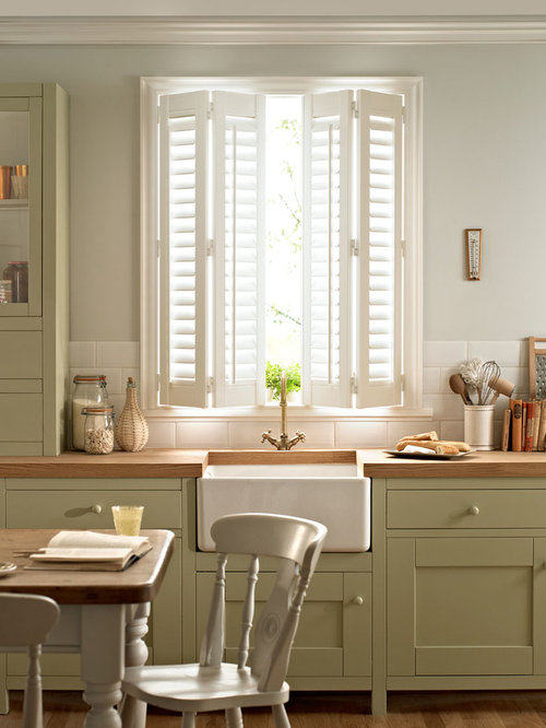 Spanish style shutters houzz for Spanish style window shutters