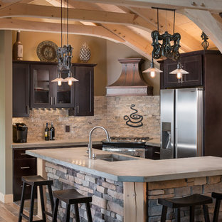 Rustic kitchen photos - Inspiration for a rustic kitchen remodel in New York with glass-front cabinets, concrete countertops, gray backsplash, stone tile backsplash, stainless steel appliances, a single-bowl sink and dark wood cabinets