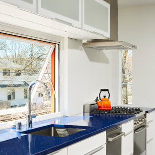 Inspiration for a midcentury kitchen in Minneapolis with an undermount sink, flat-panel cabinets, white cabinets, window splashback, stainless steel appliances and blue benchtop.
