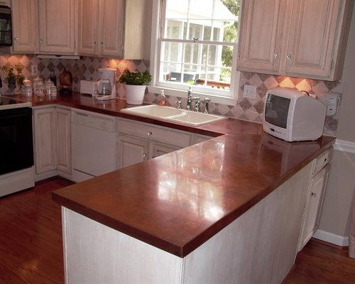 cuisine avec une cr dence en carreau de ciment et un plan. Black Bedroom Furniture Sets. Home Design Ideas