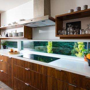 Inspiration för ett litet funkis kök med öppen planlösning, med släta luckor, skåp i mellenmörkt trä, bänkskiva i koppar, rostfria vitvaror, betonggolv och en köksö