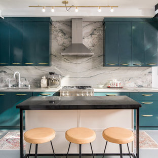 Inspiration for a contemporary open plan kitchen in Los Angeles with flat-panel cabinets, with island, an undermount sink, green cabinets, marble benchtops, grey splashback, marble splashback, stainless steel appliances, grey floor and grey benchtop.