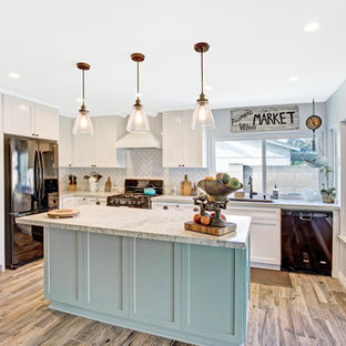 Design ideas for a mid-sized transitional l-shaped open plan kitchen in Los Angeles with an undermount sink, shaker cabinets, turquoise cabinets, marble benchtops, white splashback, marble splashback, black appliances, porcelain floors, with island, brown floor and white benchtop.