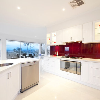Inspiration for a contemporary eat-in kitchen remodel in Melbourne with a drop-in sink, white cabinets, red backsplash and stainless steel appliances