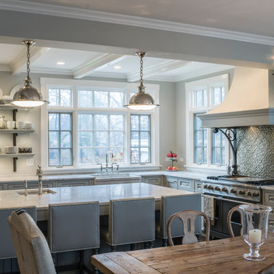 Large elegant l-shaped eat-in kitchen photo in Chicago with a farmhouse sink, stainless steel appliances, beaded inset cabinets, gray cabinets, marble countertops, metallic backsplash, metal backsplash, an island and gray countertops