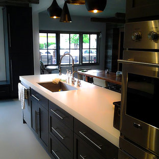 Inspiration for a large arts and crafts galley eat-in kitchen in Los Angeles with open cabinets, dark wood cabinets, solid surface benchtops, white splashback, marble splashback, with island and white floor.