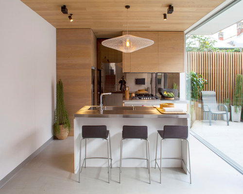 This Is An Example Of A Small Contemporary Galley Kitchen In Melbourne With  An Integrated Sink