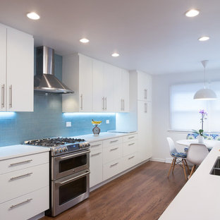 Inspiration for a mid-sized modern galley eat-in kitchen in Chicago with an undermount sink, flat-panel cabinets, white cabinets, copper benchtops, blue splashback, subway tile splashback, stainless steel appliances, medium hardwood floors and no island.