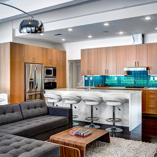 Inspiration for a midcentury l-shaped open plan kitchen in Detroit with flat-panel cabinets, light wood cabinets, blue splashback and stainless steel appliances.
