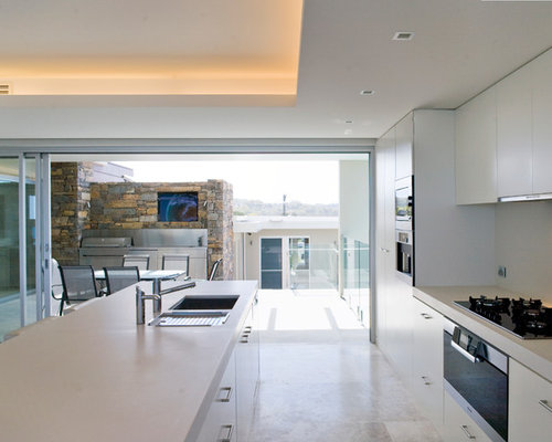 Minimalist kitchen photo in Sydney with flat-panel cabinets