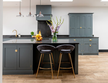 Sleek, stylish and sophisticated dark teal flat panelled kitchen with island
