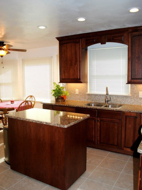 Kitchen remodel with cherry cabinets and cambria canterbury quartz