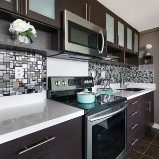 Design ideas for a small contemporary single-wall open plan kitchen in Hawaii with an undermount sink, flat-panel cabinets, dark wood cabinets, solid surface benchtops, multi-coloured splashback, mosaic tile splashback, stainless steel appliances, ceramic floors and with island.
