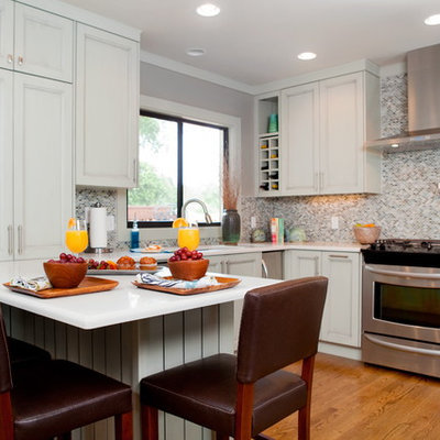 Inspiration for a timeless kitchen remodel in Miami with recessed-panel cabinets, multicolored backsplash, mosaic tile backsplash and stainless steel appliances