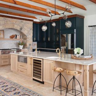 Huge mediterranean kitchen designs - Kitchen - huge mediterranean l-shaped beige floor and exposed beam kitchen idea in Austin with an undermount sink, an island, raised-panel cabinets, medium tone wood cabinets, beige backsplash, paneled appliances and beige countertops