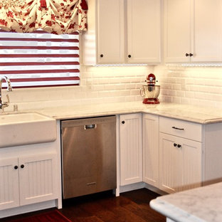 Shabby-chic style eat-in kitchen remodeling - Cottage chic u-shaped medium tone wood floor eat-in kitchen photo in San Diego with a farmhouse sink, beaded inset cabinets, white cabinets, marble countertops, red backsplash, glass tile backsplash, stainless steel appliances and a peninsula
