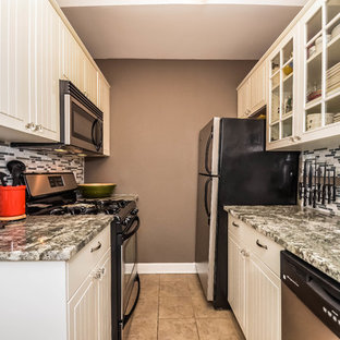 Enclosed kitchen - small traditional galley enclosed kitchen idea in New York with white cabinets, granite countertops, gray backsplash, mosaic tile backsplash, stainless steel appliances, no island and an undermount sink