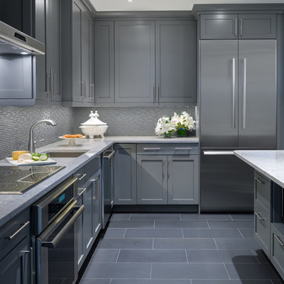 Small trendy galley ceramic tile kitchen photo in Other with an undermount sink, gray cabinets, glass tile backsplash, stainless steel appliances and a peninsula