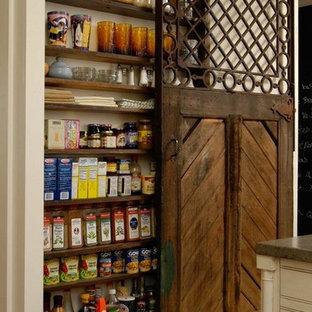 This is an example of a small country single-wall kitchen pantry in San Francisco.