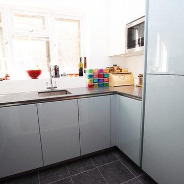 Small U shaped blue kitchen
