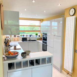 Small, unorganised kitchen transformed to a bright modern space.