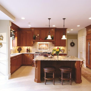 Example of a classic kitchen design in DC Metro with paneled appliances and limestone backsplash