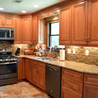 Inspiration for a mid-sized transitional l-shaped slate floor eat-in kitchen remodel in Atlanta with a double-bowl sink, raised-panel cabinets, medium tone wood cabinets, granite countertops, green backsplash, stone tile backsplash and colored appliances