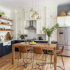 Two-Tone Cabinets and an Open Wood Island in a Sunny Kitchen
