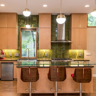 Photo of a mid-sized midcentury kitchen in Austin with flat-panel cabinets, light wood cabinets, quartz benchtops, green splashback, porcelain splashback, stainless steel appliances, ceramic floors, with island and a double-bowl sink.