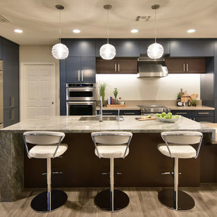 Large transitional eat-in kitchen remodeling - Large transitional porcelain tile and beige floor eat-in kitchen photo in Phoenix with an undermount sink, flat-panel cabinets, blue cabinets, quartz countertops, white backsplash, porcelain backsplash, stainless steel appliances and an island