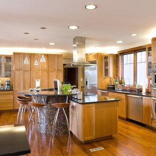 Kitchen - modern kitchen idea in Philadelphia with mosaic tile backsplash, stainless steel appliances and granite countertops